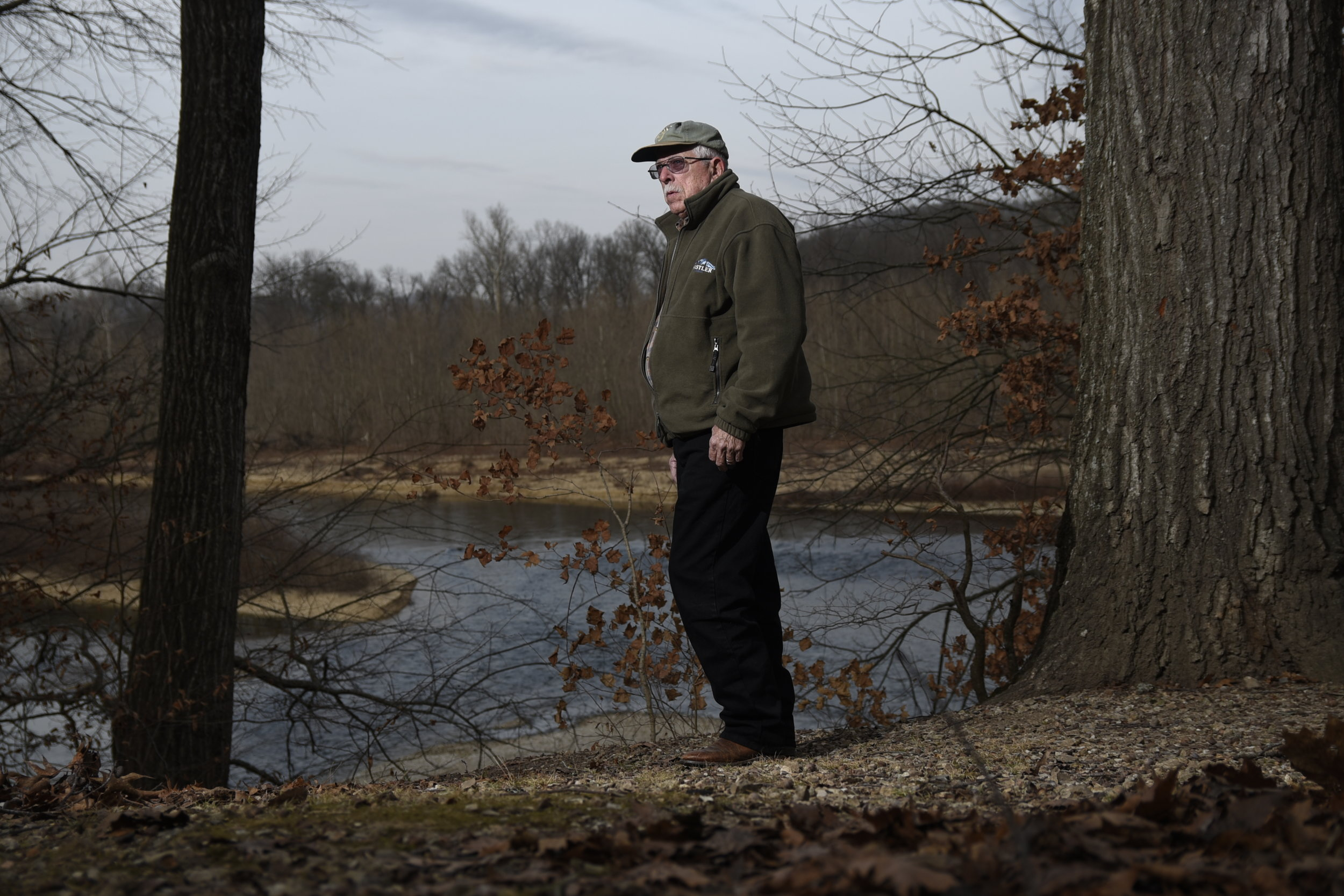 Ed Brocksmith poses along the Illinois River. He is a co-founder of the non-profit organization Save The Illinois River. CREDIT: Nick Oxford for The New York Times