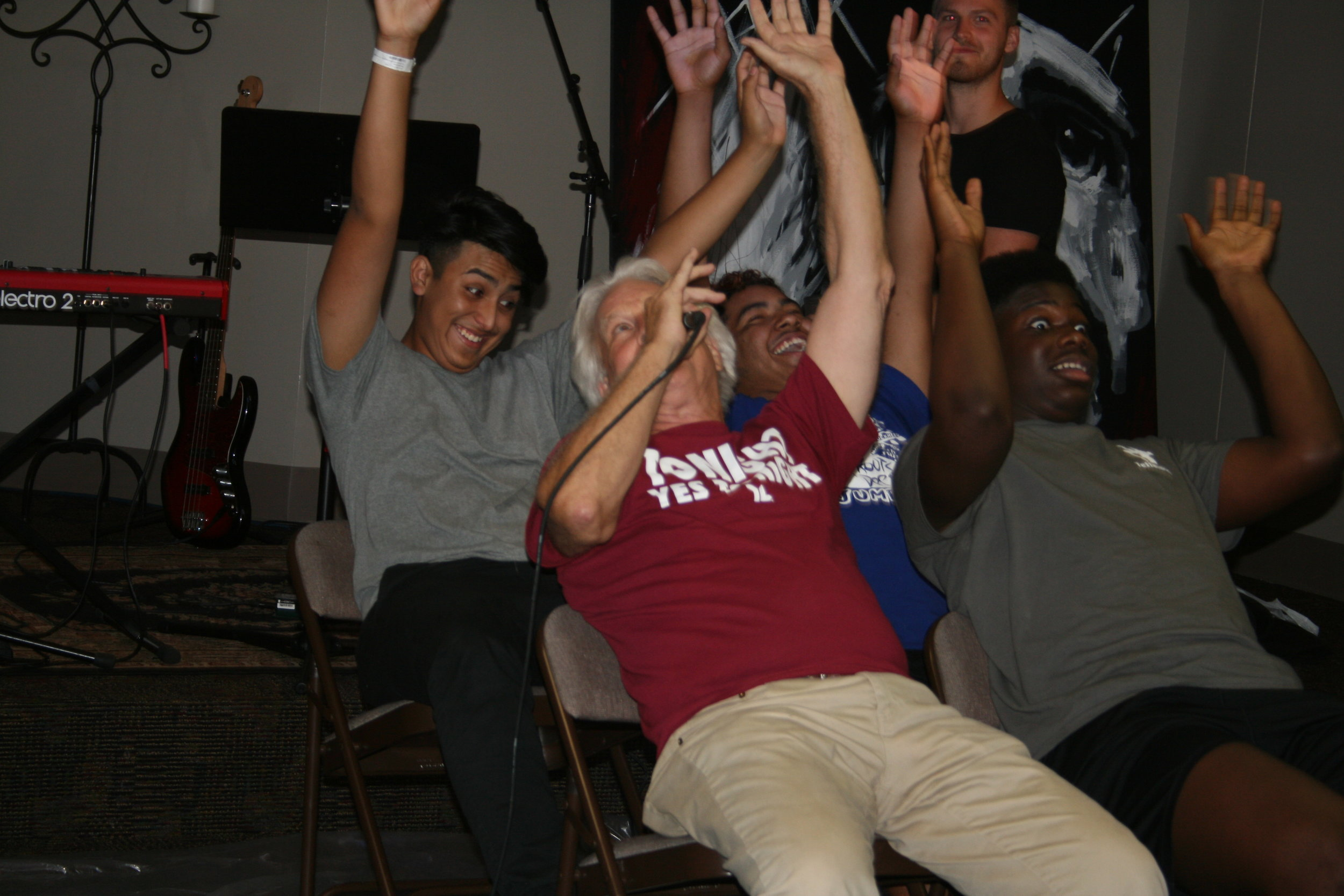 "Richard leading the ""Roller Coaster Skit"" at club"