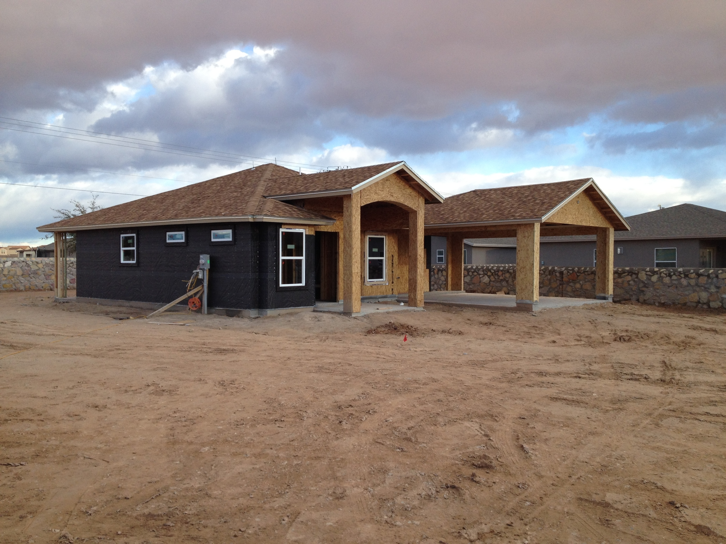 The house near the final stage of construction is prepared for stucco.