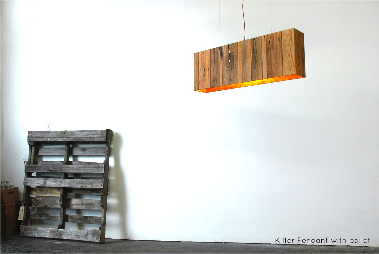 """Kilter Pendant - 38"""" x 6"""" x 13"""", reclaimed pallet wood   Beautiful joinery and a little elbow grease reshape oak hardwood from disused shipping pallets into a minimal modern light.   propellor.ca"""