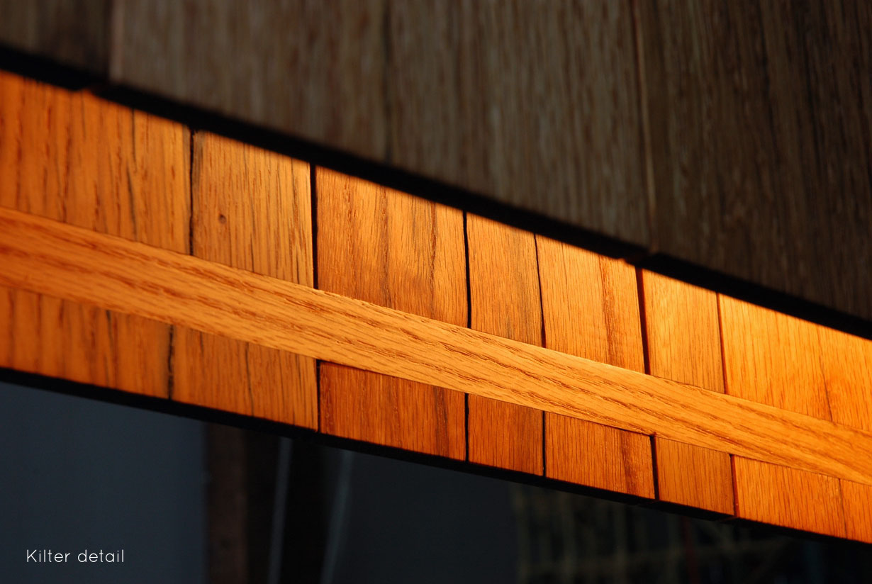 Kilter Pendant - detail, reclaimed pallet wood   Beautiful joinery and a little elbow grease reshape oak hardwood from disused shipping pallets into a minimal modern light.   propellor.ca