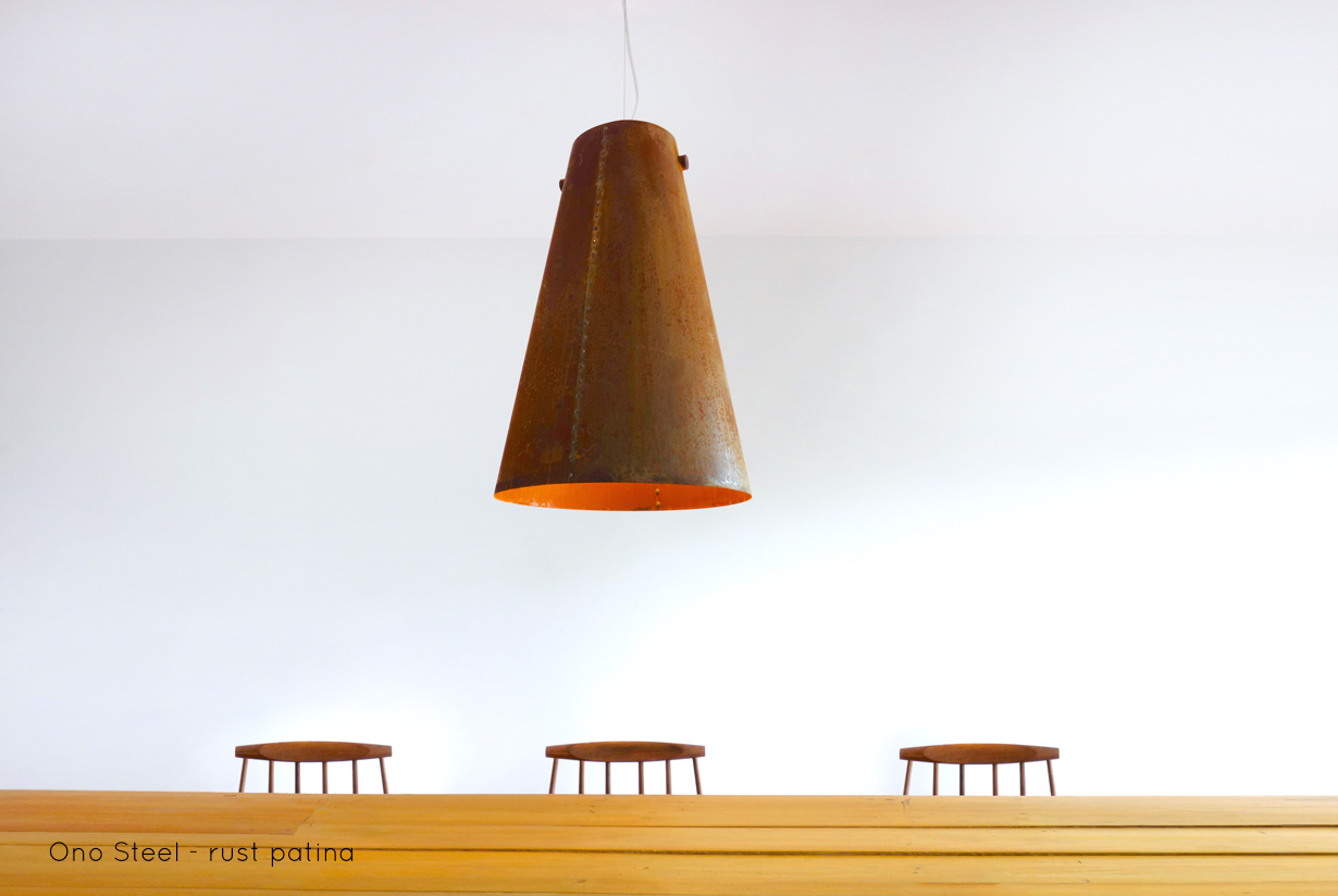 Ono Steel Pendant | With the Ono Steel light we explore the beauty and warmth of rusted metal. The Ono Steelis hand riveted, lit with anLED lamp and hung from a solid walnut spindle. | propellor.ca
