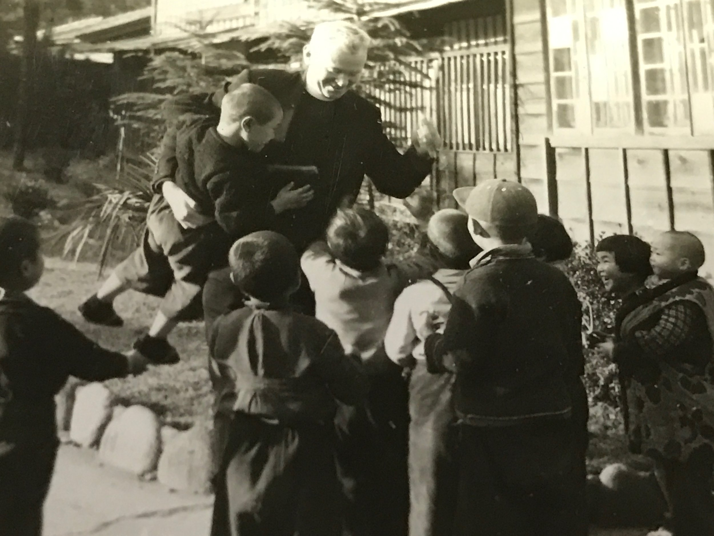 1954 Nagasaki--Father Purcell with Japanese Children