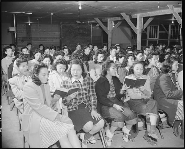Practising Christmas carols, 1944, Granada Relocation Center, Colorado. Tom Parker, Wikimedia