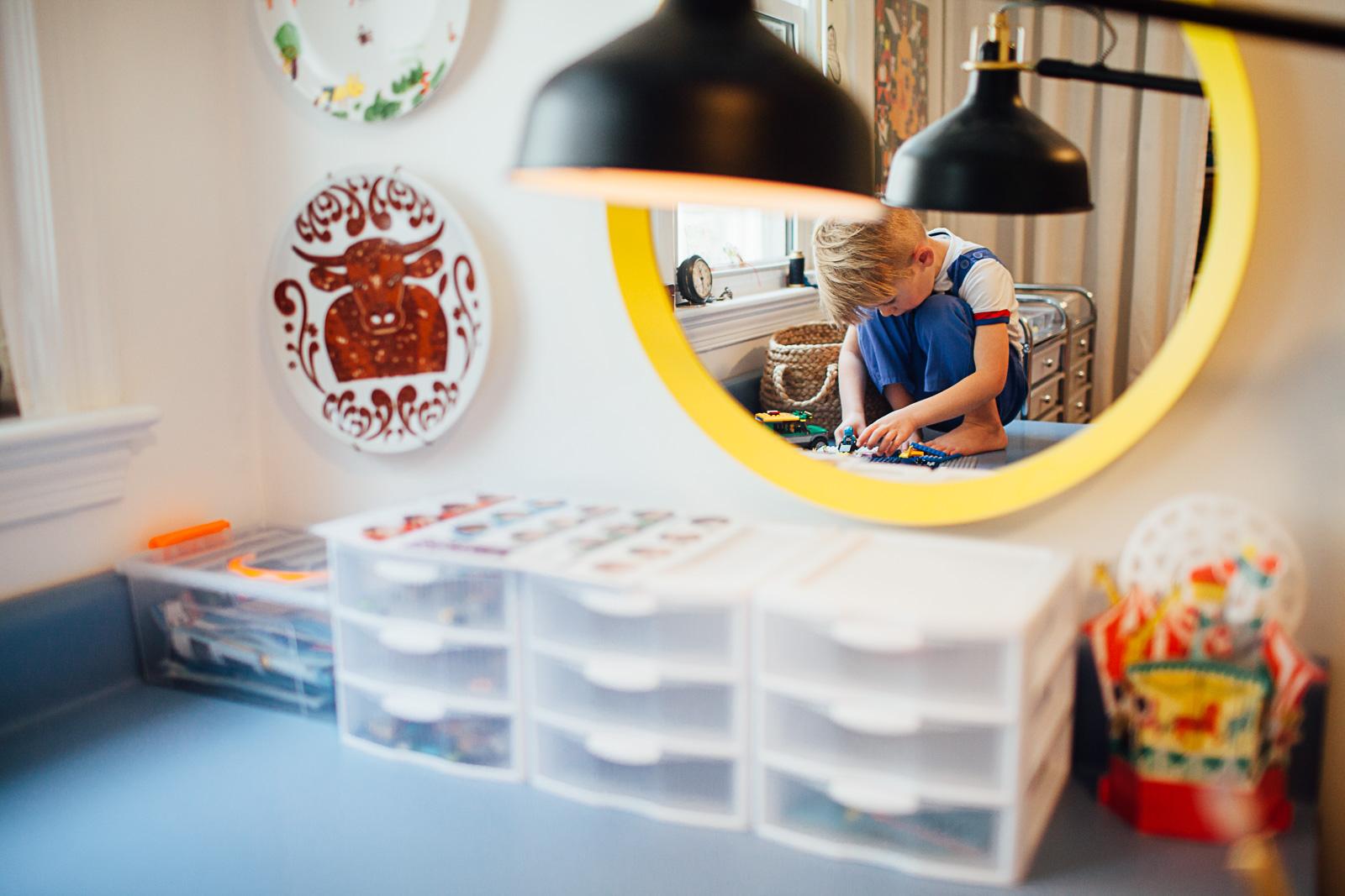 Boy playing legos on a desk