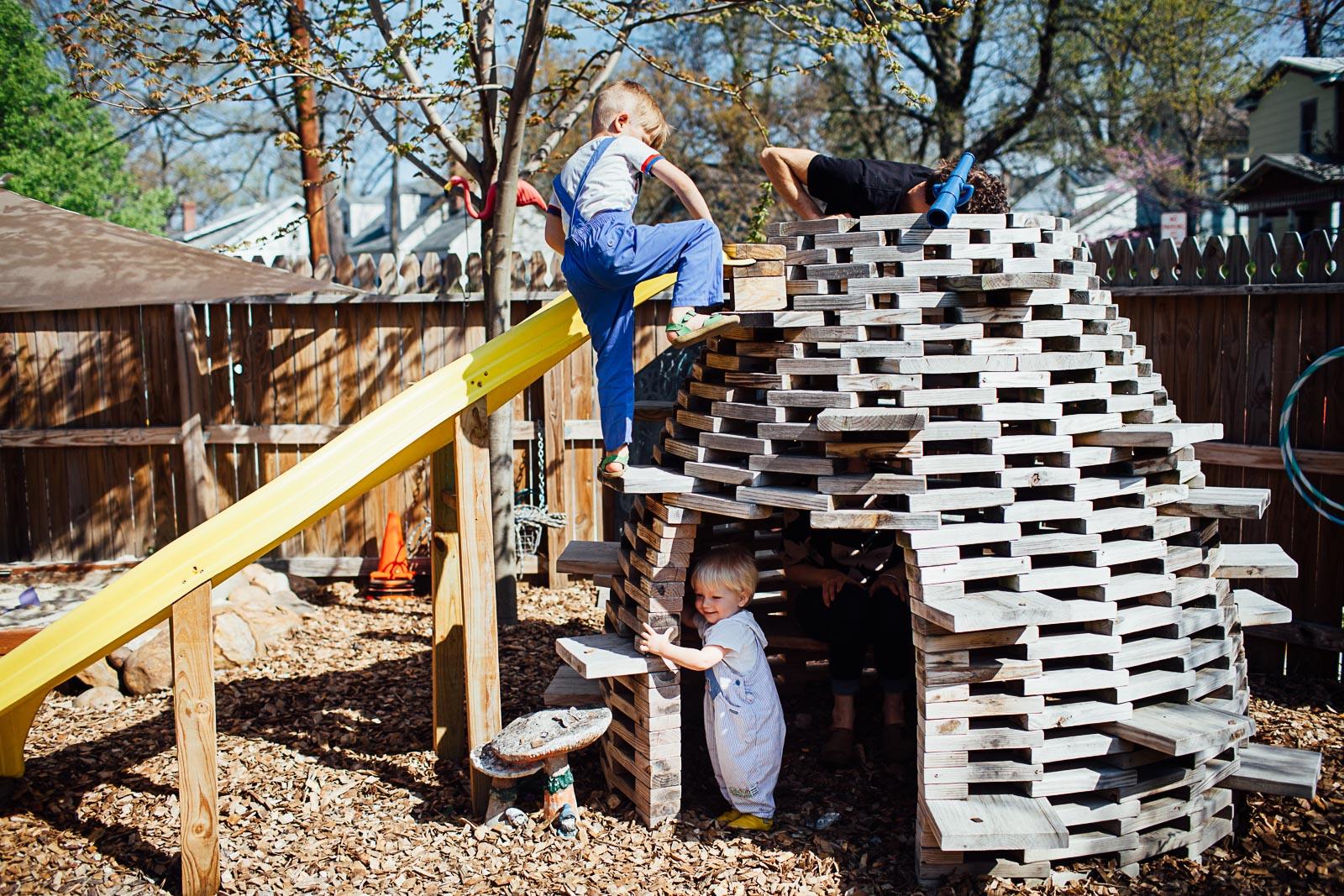boy climbing a homemade hive