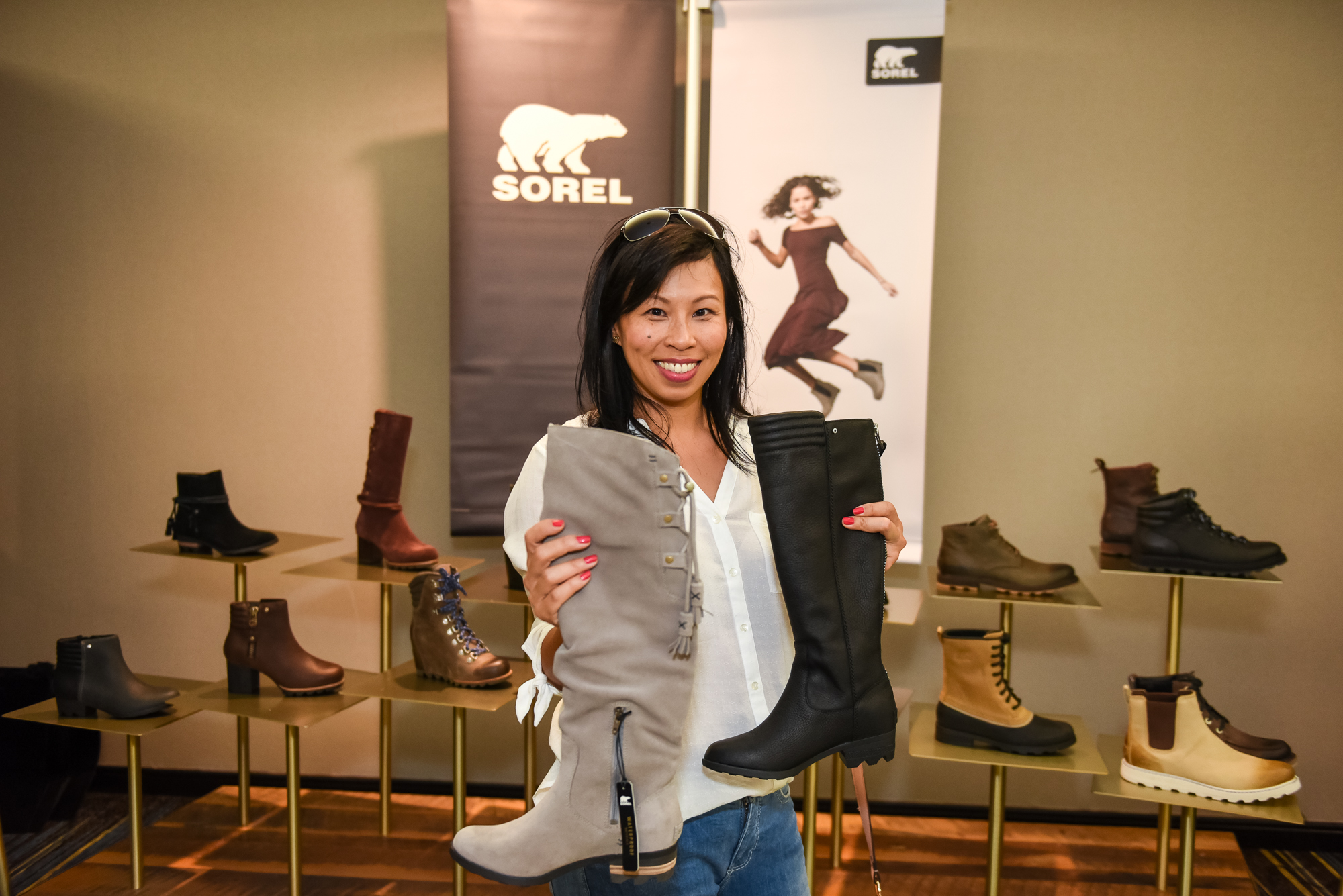 Breakfast Television's Pay Chen decides between some Sorel boots Photo: Nick Wons