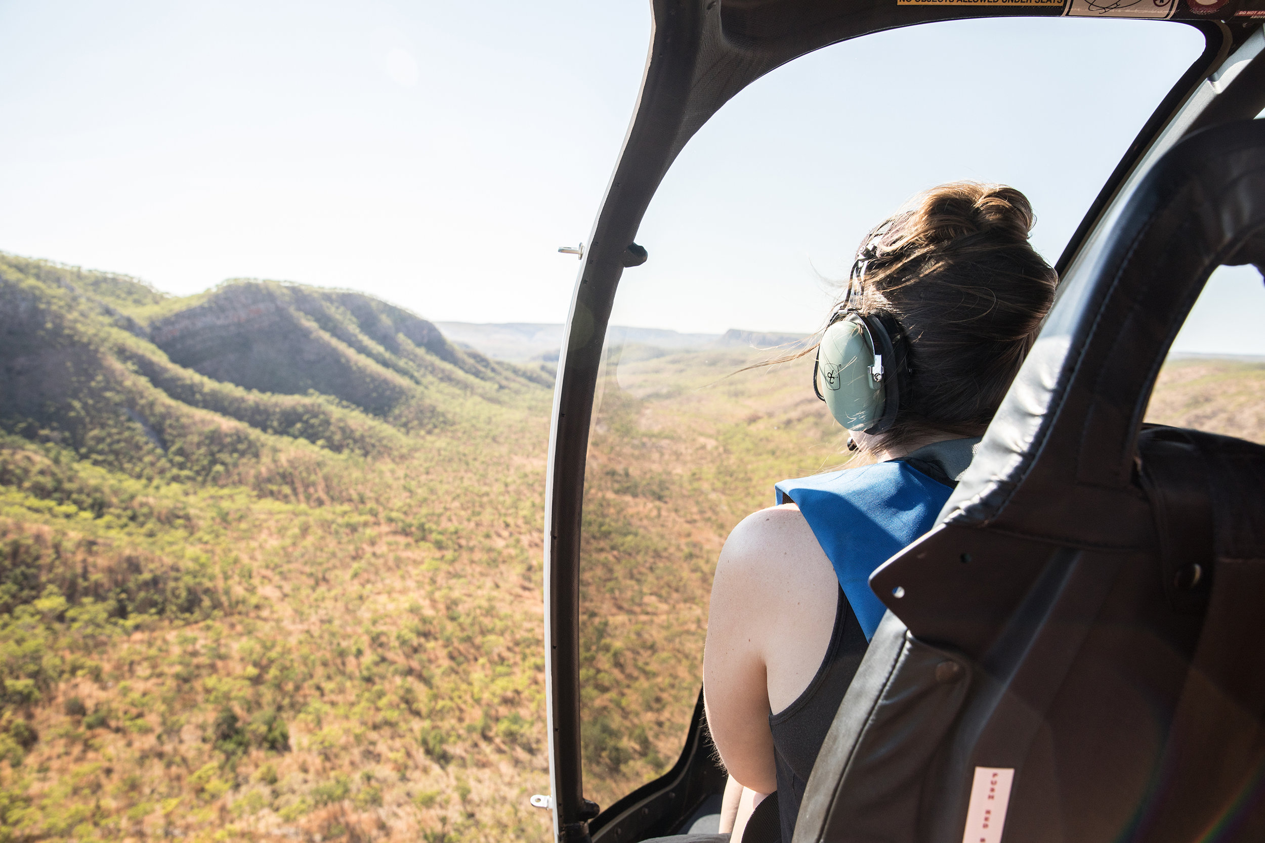 Flying in a helicopter over the wilderness of The Kimberley.