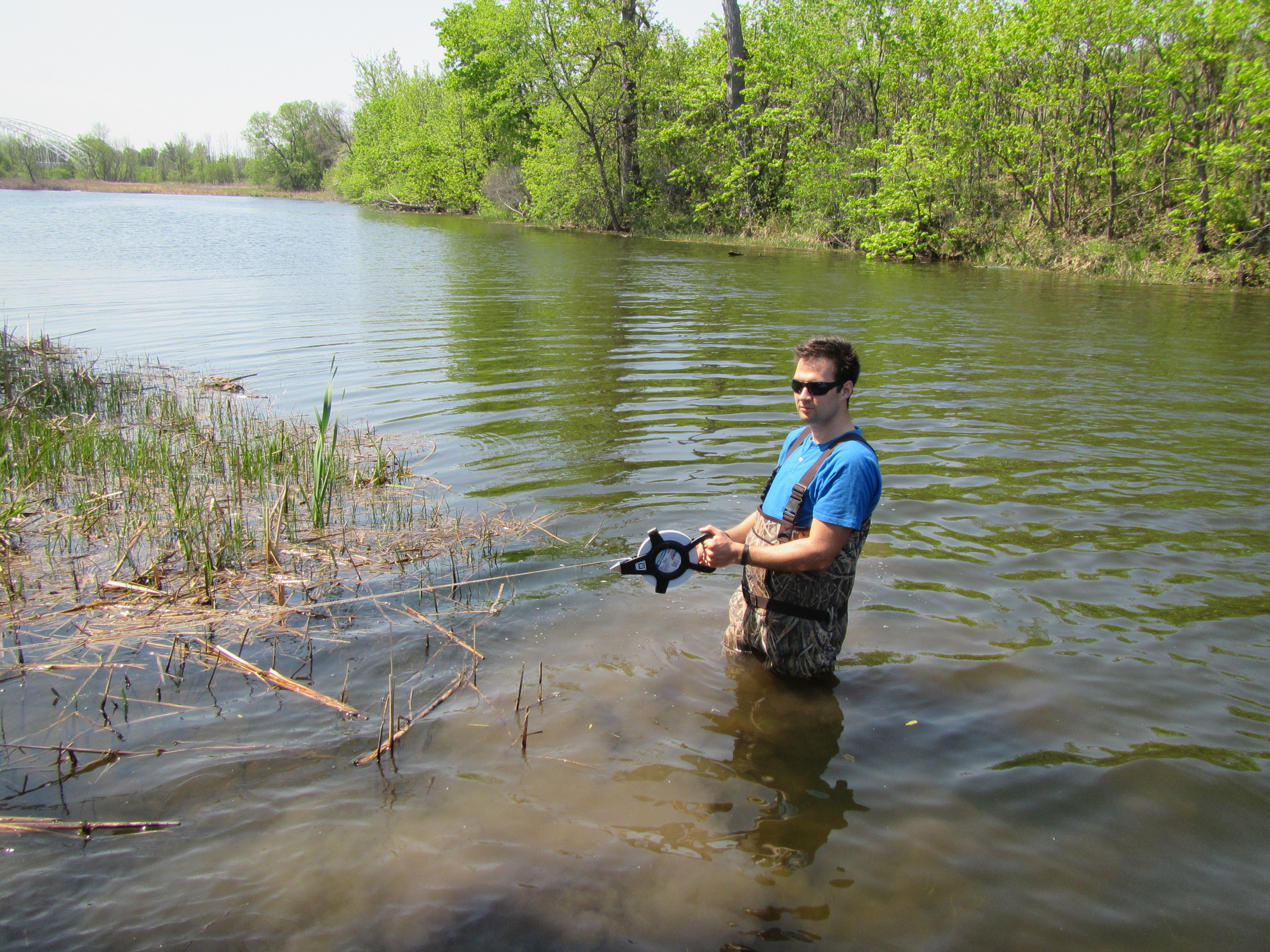 Dr. McKinley taking measurements for a Headwaters Drainage Assessment Study
