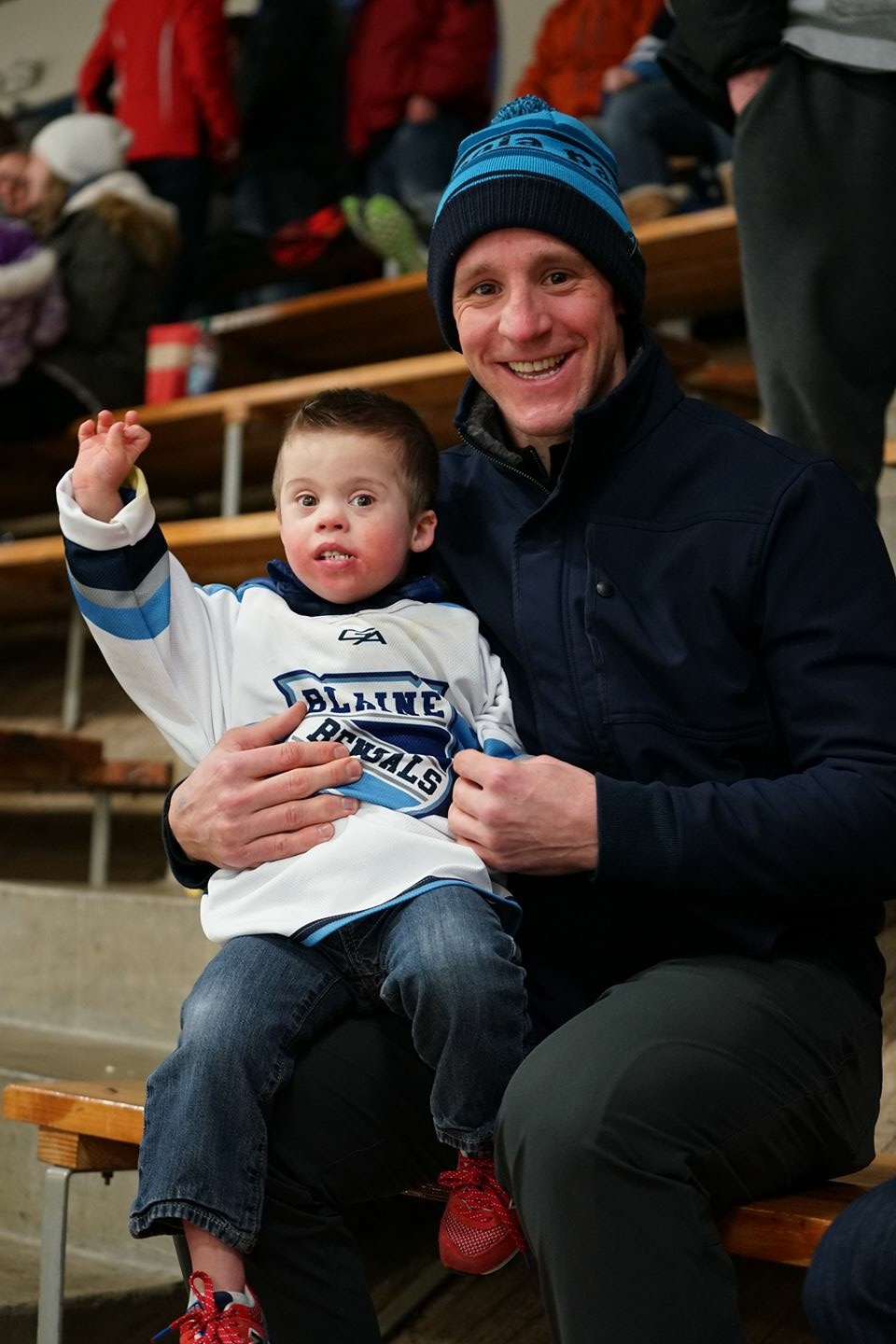 Jack and Andrew cheering on Chris' Blaine Bengal hockey team