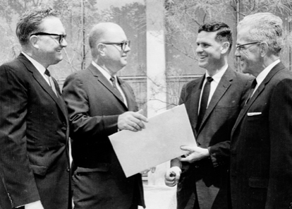 John Desmond receiving an American Institute of Architects award for his design of the new State Library building in Baton Rouge, LA. Photo circa 1958. Louisiana Historical Photographs of the State Library.