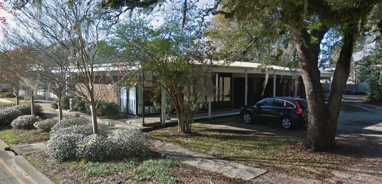5. JOHN DESMOND ARCHITECTURAL OFFICES    406 W. Morris Avenue   Architect: John Desmond Constructed: c. 1960  Behind the miller memorial library is the building that john desmond designed to house his office. it, like the library, is also predominantly intact. The only major exterior renovation was the addition of a pitched roof. The Mid-Century Modern style incorporated the flat roof into designs, but over time buildings in this region had to adjust because of heavy rainfall.