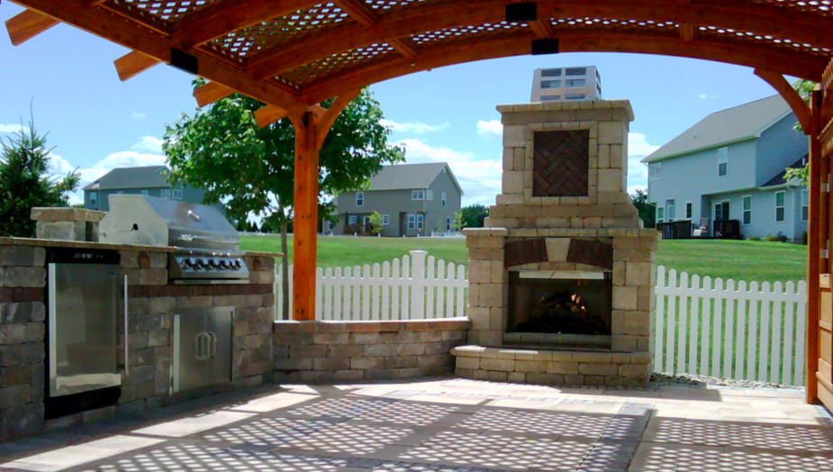 Outdoor fireplace as an idea for landscaping design esentials