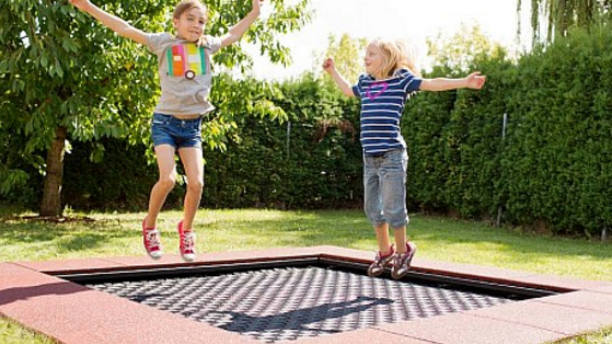 Built in trampoline for a fun backyard idea