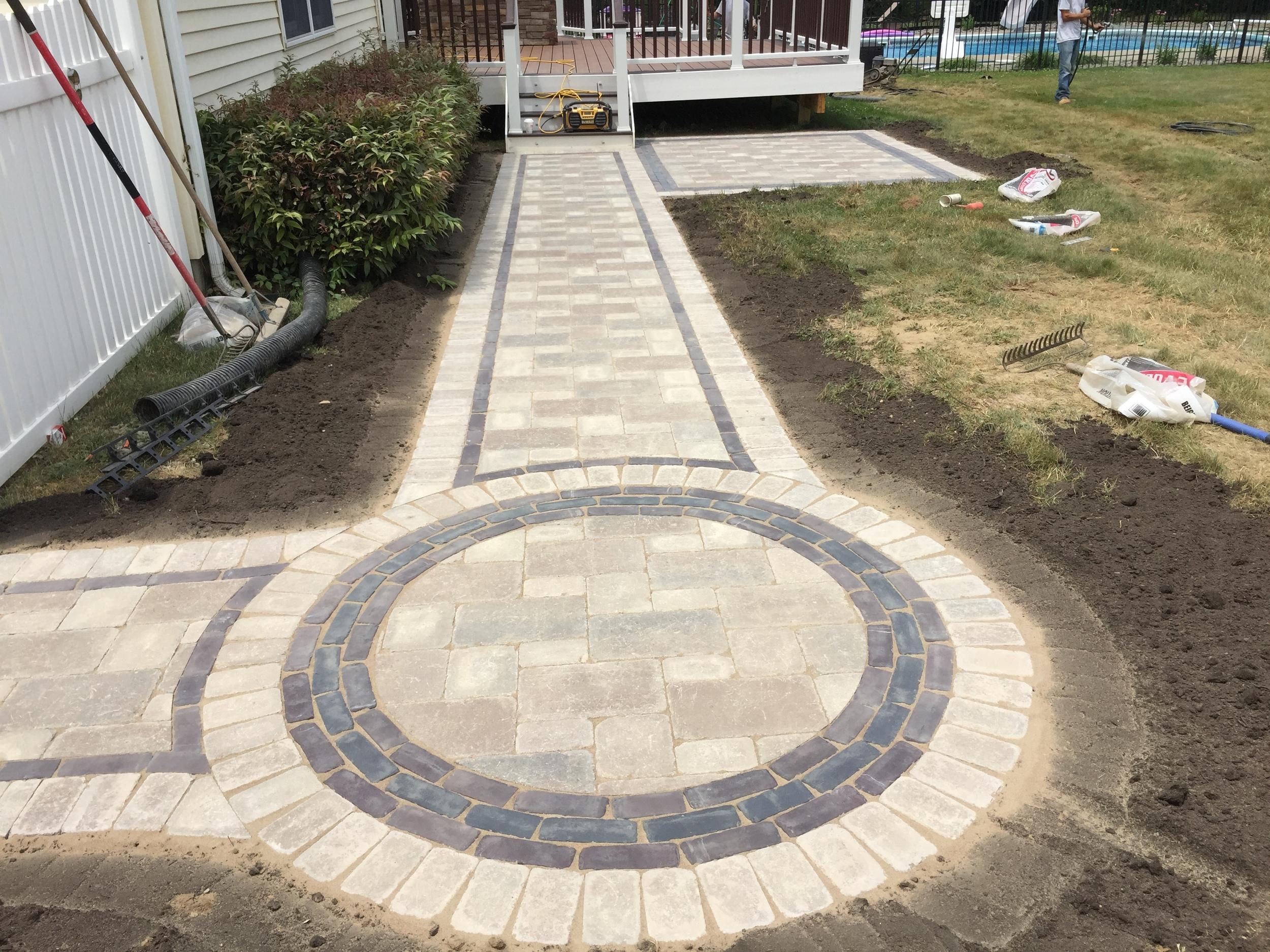 Photos of Custom Unilock Walkway ny Harmony Hill Landscaping during installation in Dutchess County, NY