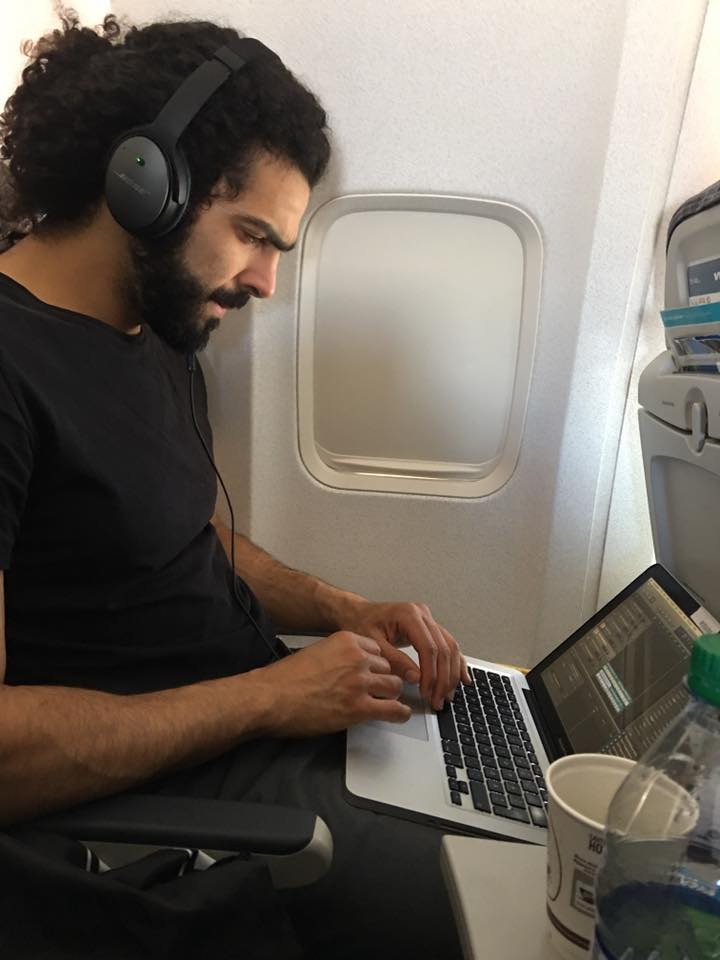 Even in flight Ramy is composing...music machine at work. Heading to Folk Fest 2017.