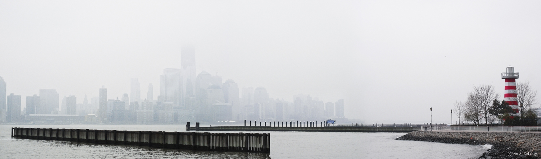 Manhattan Skyline in Fog with Lighthouse, 2012