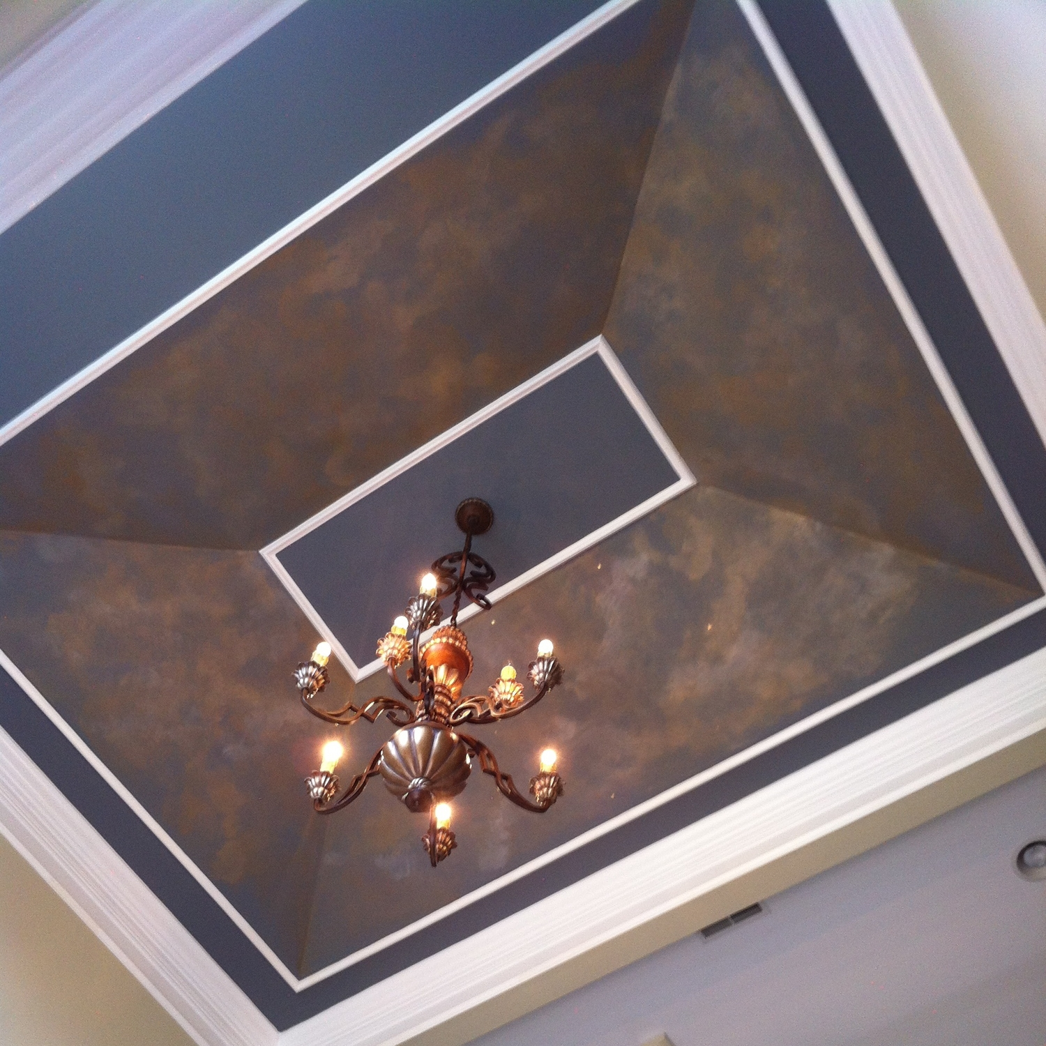 Aged Metallic Foyer Ceiling