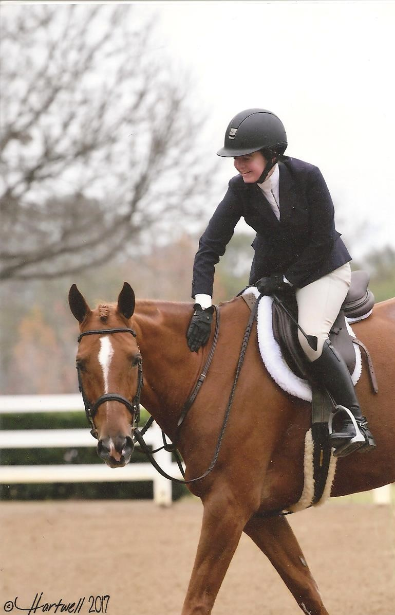 Katie's all smiles after a course with Cinco in the Children's Hunters. Photo credits to Alison Hartwell.