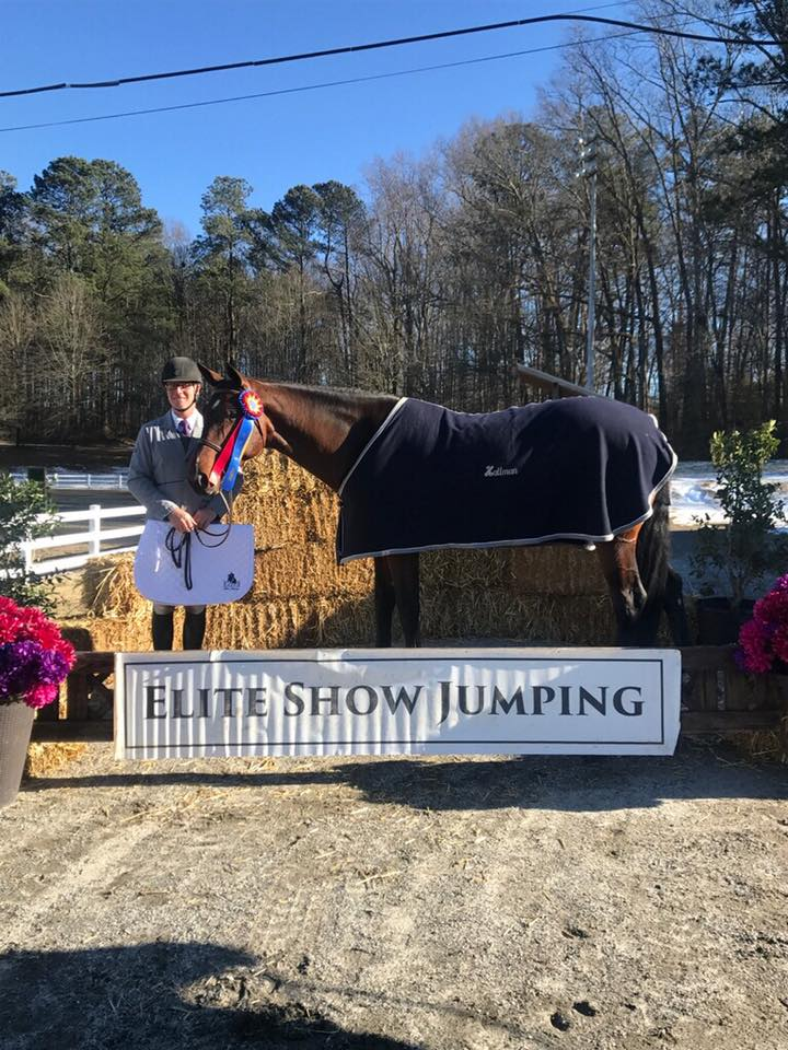 Michael and Gracie with their High Performance division champion ribbon. Note the snow still on the ground in the background!