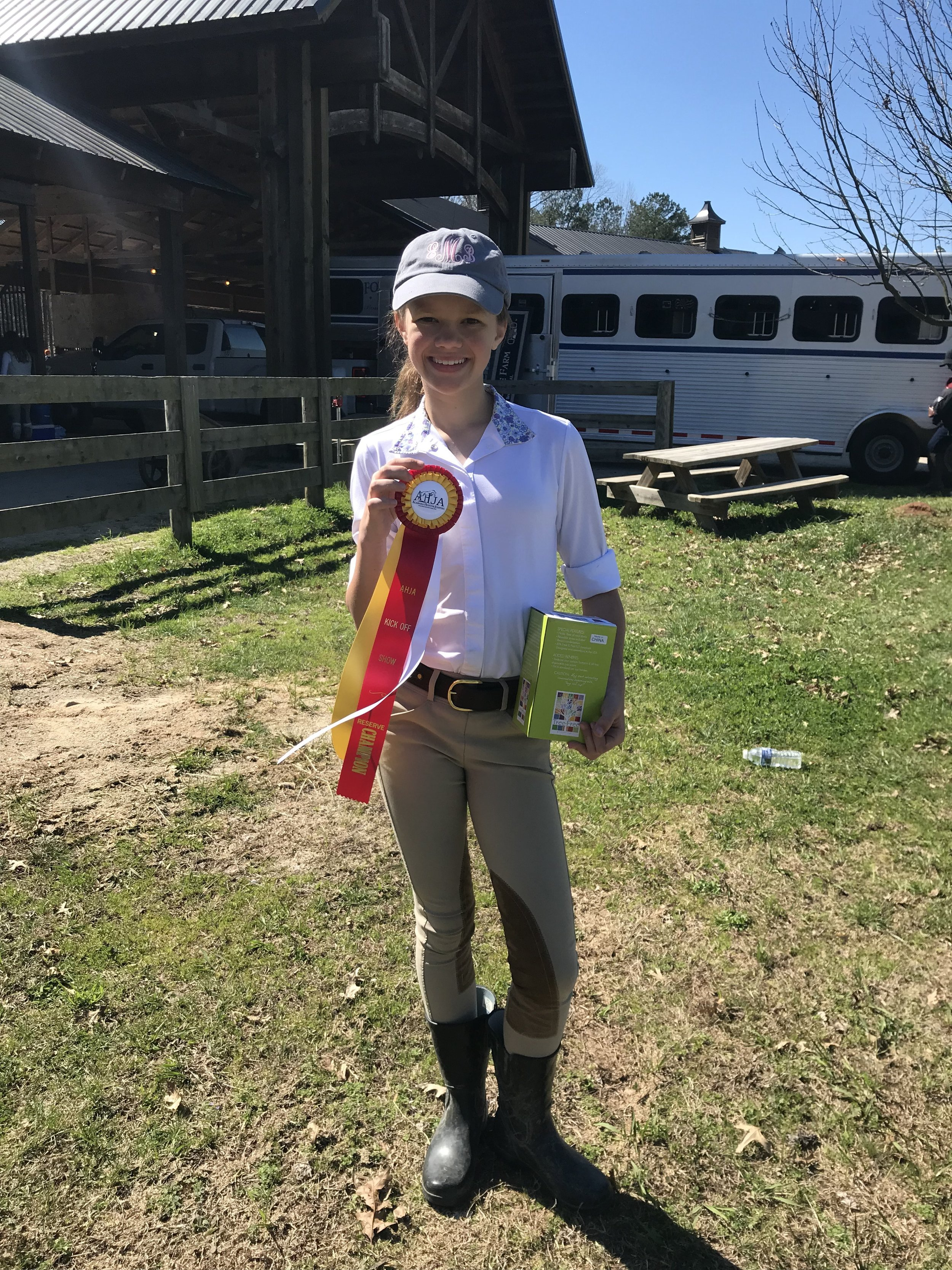 Bates Moody sporting her Reserve Champion ribbon and prize!
