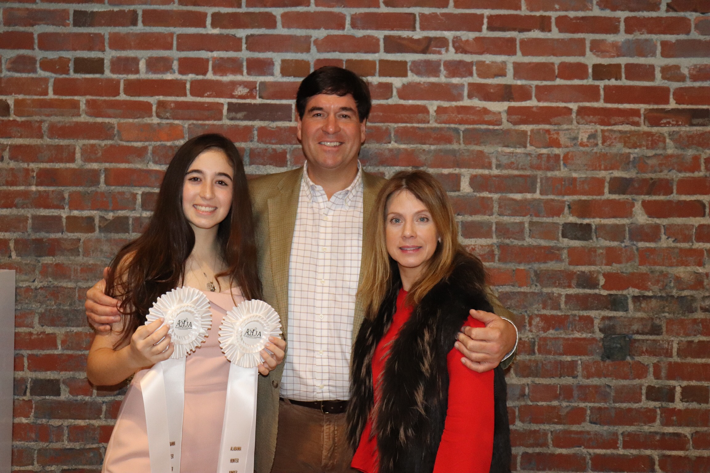 Paloma and her parents celebrating her 2018 successes!