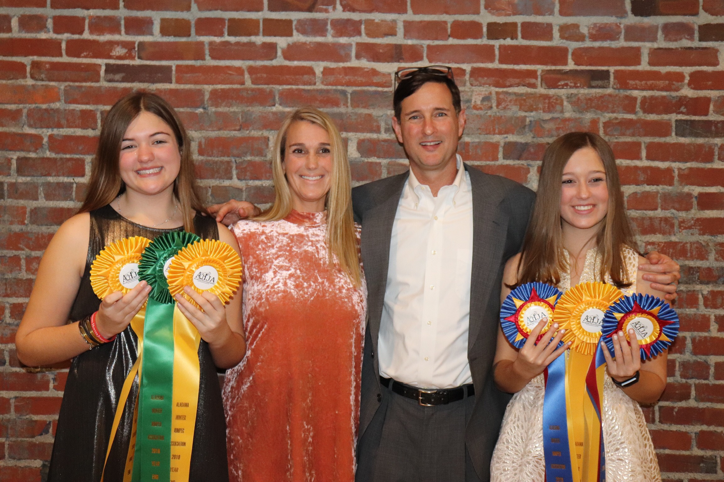 Lauren (left) and Sydney Velazquez with parents Romney and Andy.