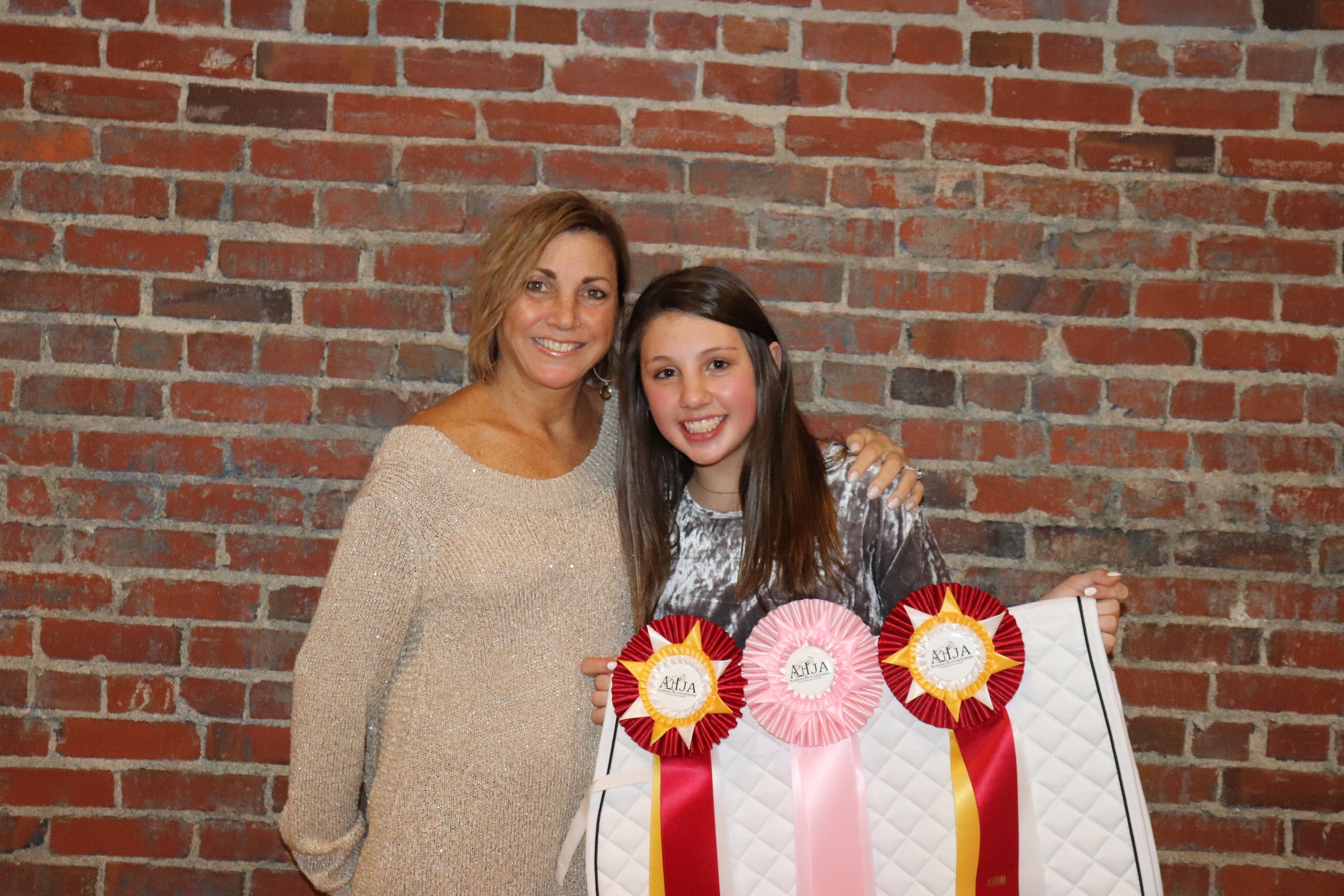 Emma Grace Early showing off her 2 Reserve Champion prizes and 5th place equitation ribbon with mom Lisa.