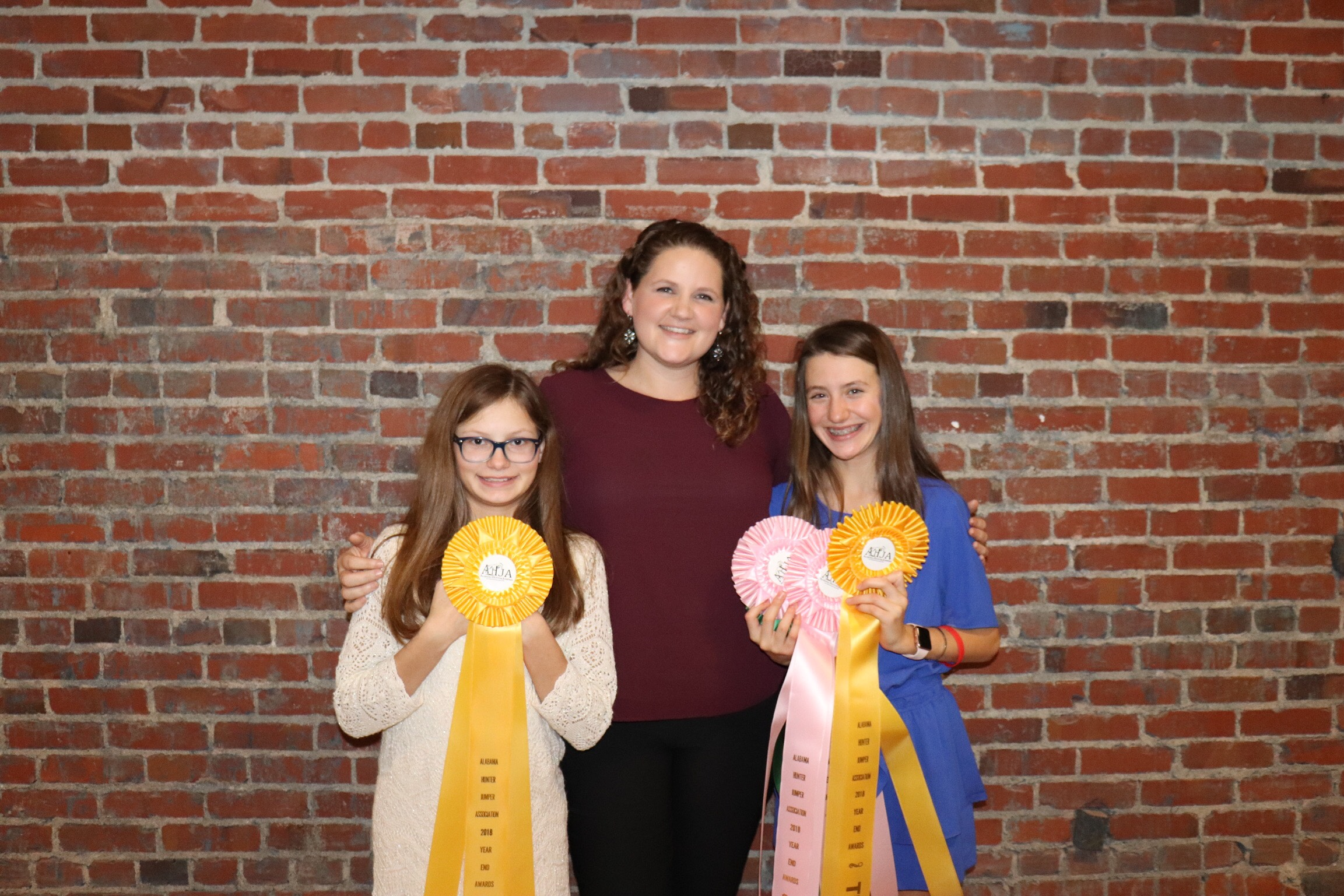Sarah Carson Hill (left) and Julia King with their pony hunter ribbons.