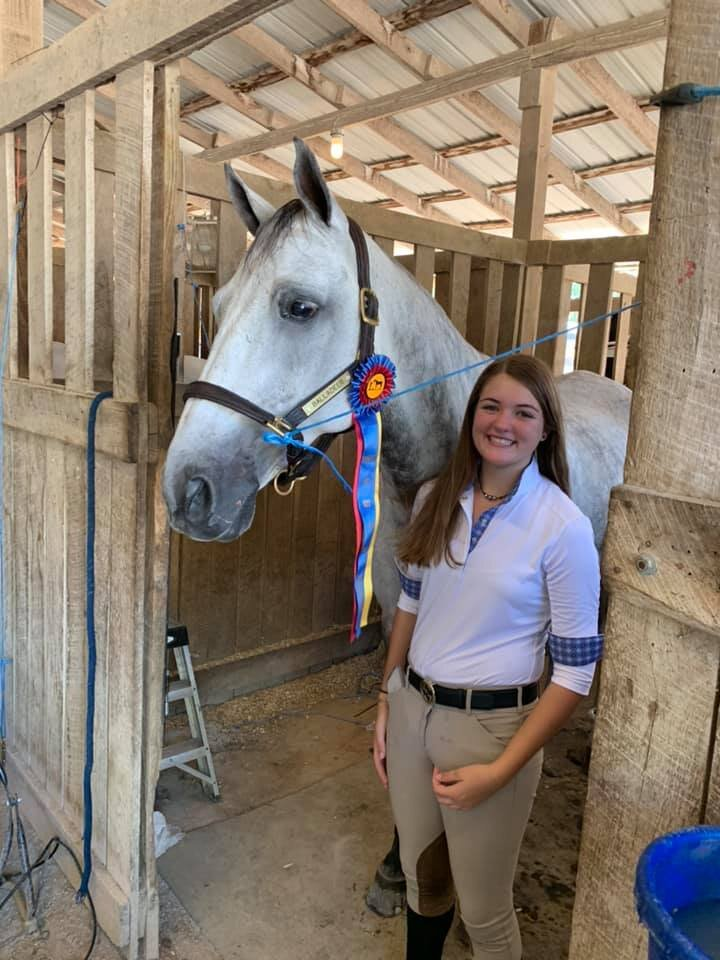 "Lauren and ""Captain"" with their Champion prize. Lauren and Captain paired up earlier this year and have had much success together."