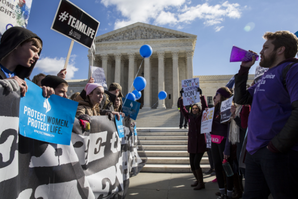 Protesters take sides outside the Supreme Court