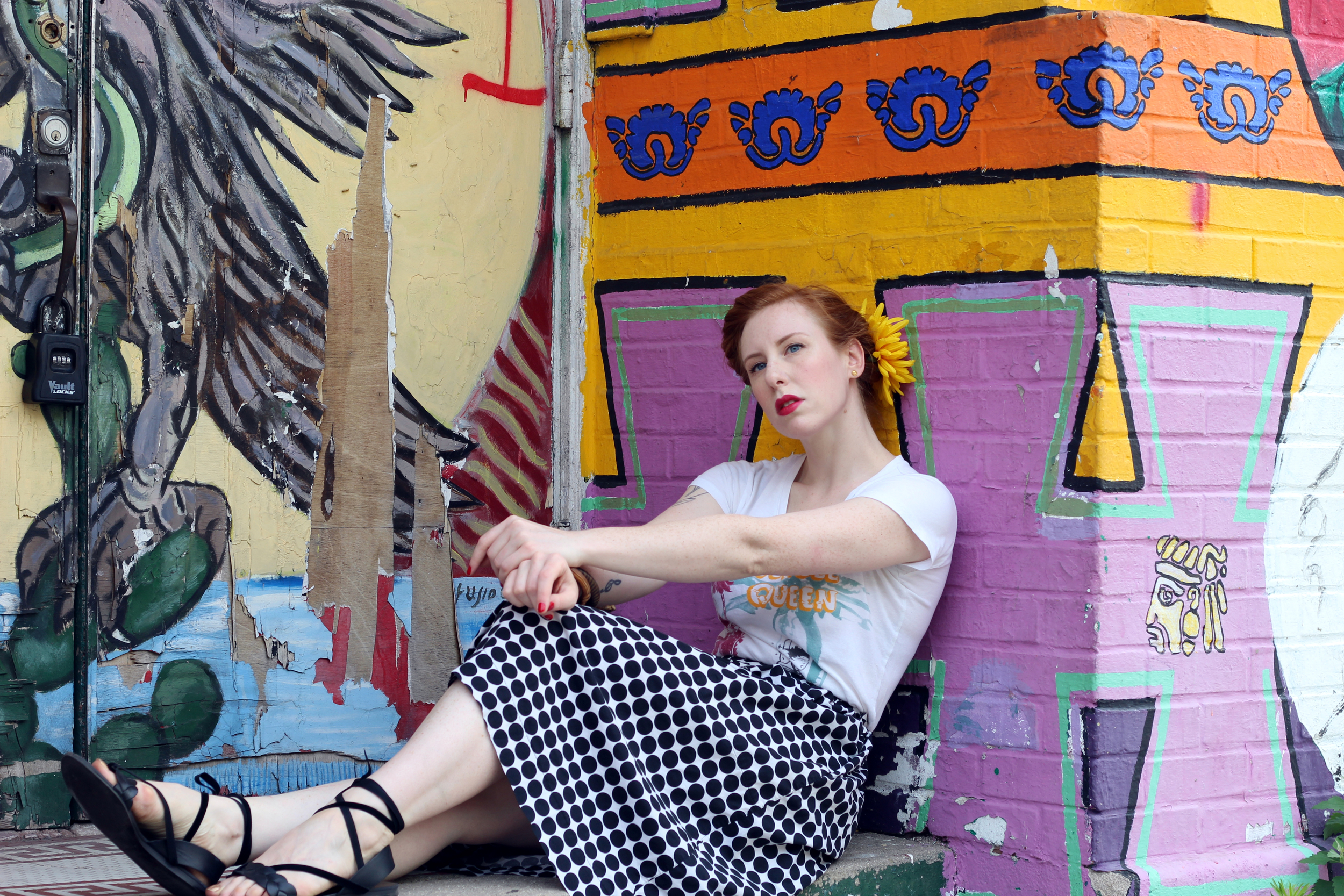 Zella Maybe in a polka dot skirt and Jungle Queen Bettie Page top, and a pair of ankle wrap sandals. Shot in Pilsen, Chicago.