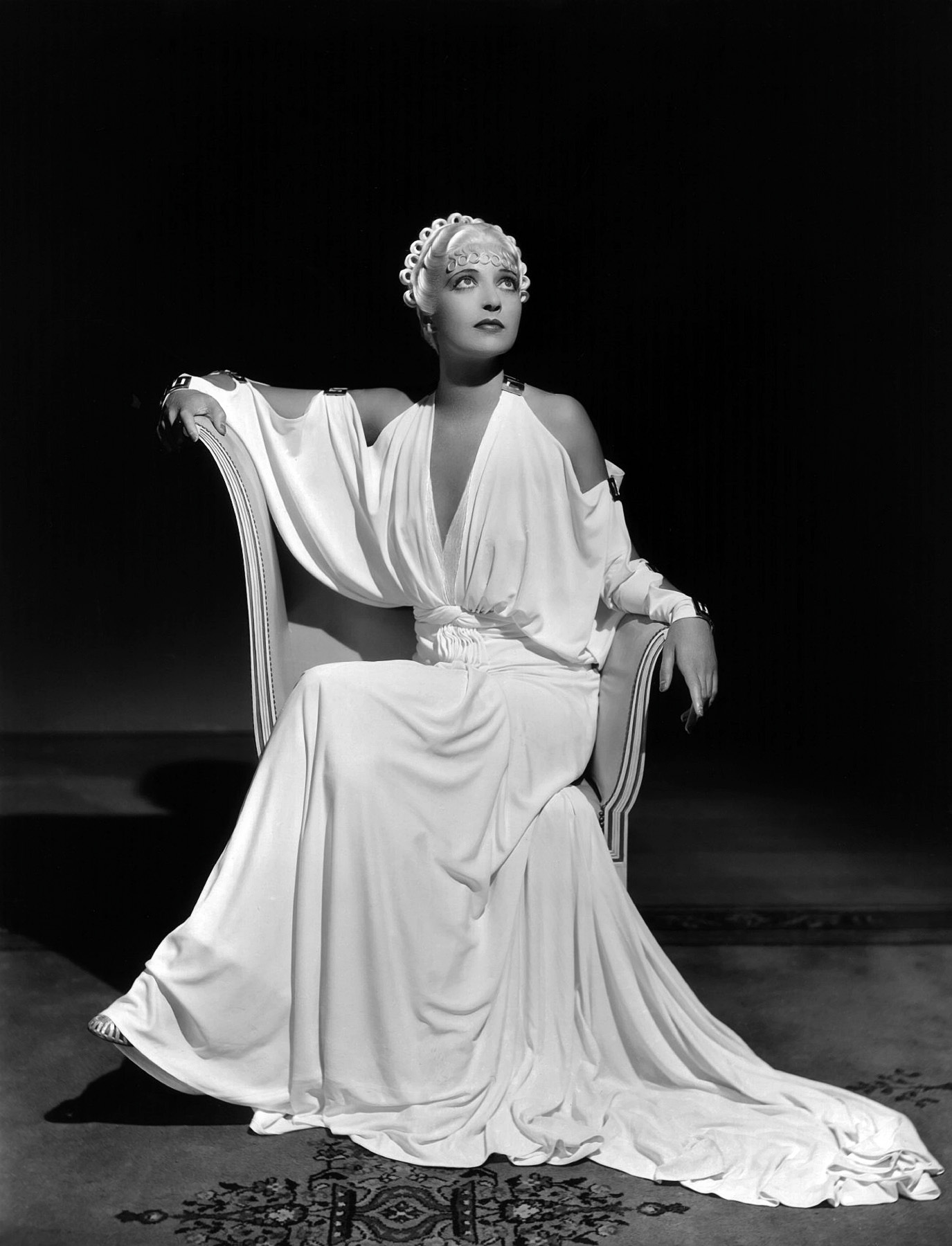 Not totally sure who this is. I thought Bette Davis, but maybe Dolores del Rio in a blonde wig? Either way, this dress is  killer .