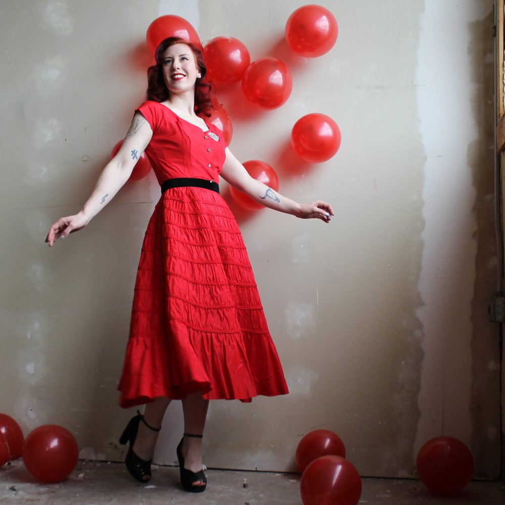 You can't really do much set dressing out in the real world, but even something as small as taping a few balloons to a wall added just the right touch to this Valentines themed photo shoot.