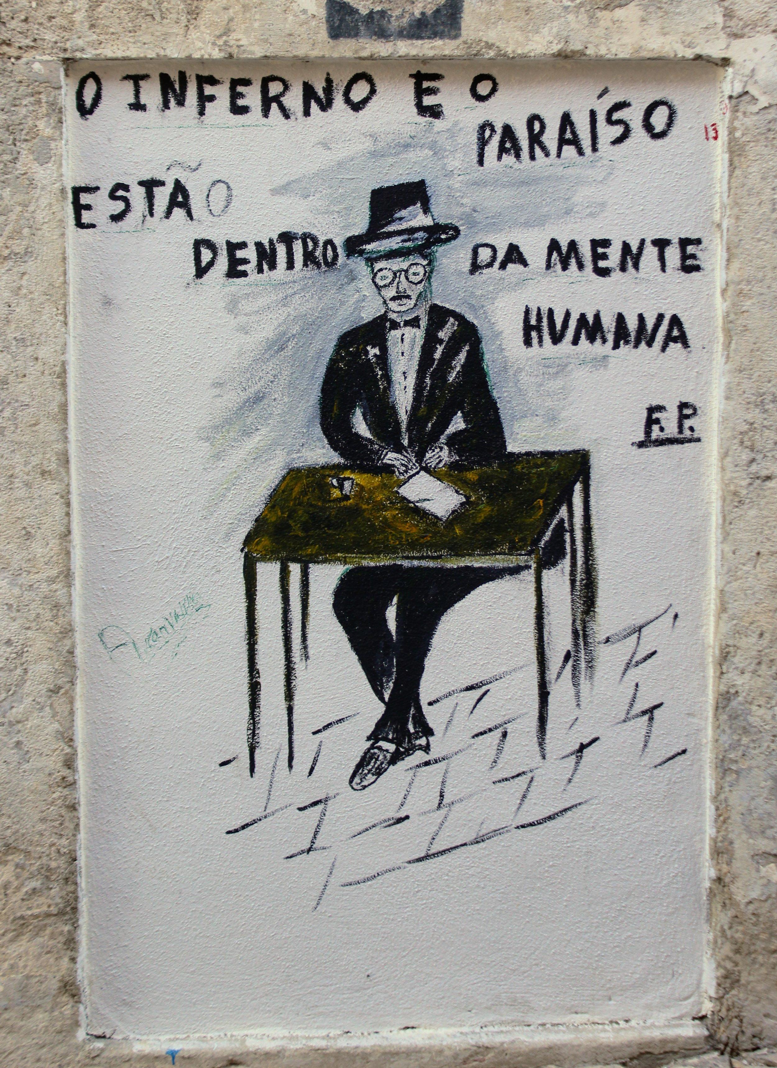 Street art featuring celebrated Portuguese poet Fernando Pessoa.
