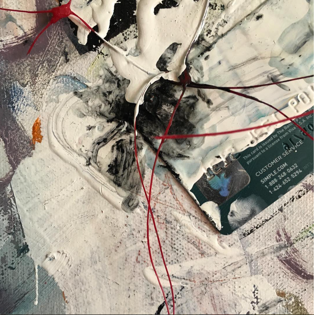 Detail of a new  Plastic Piece which includes an expired bank card and red plastic netting