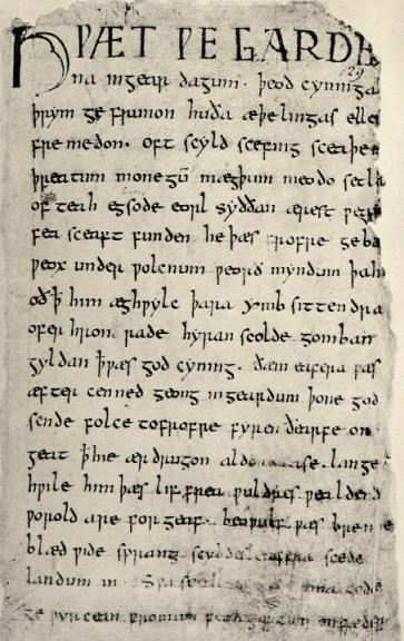 """The  first page  of the  Beowulf  manuscript. """"LO, praise of the prowess of people-kings of spear-armed Danes, in days long sped, we have heard, and what honor the athelings won!"""""""
