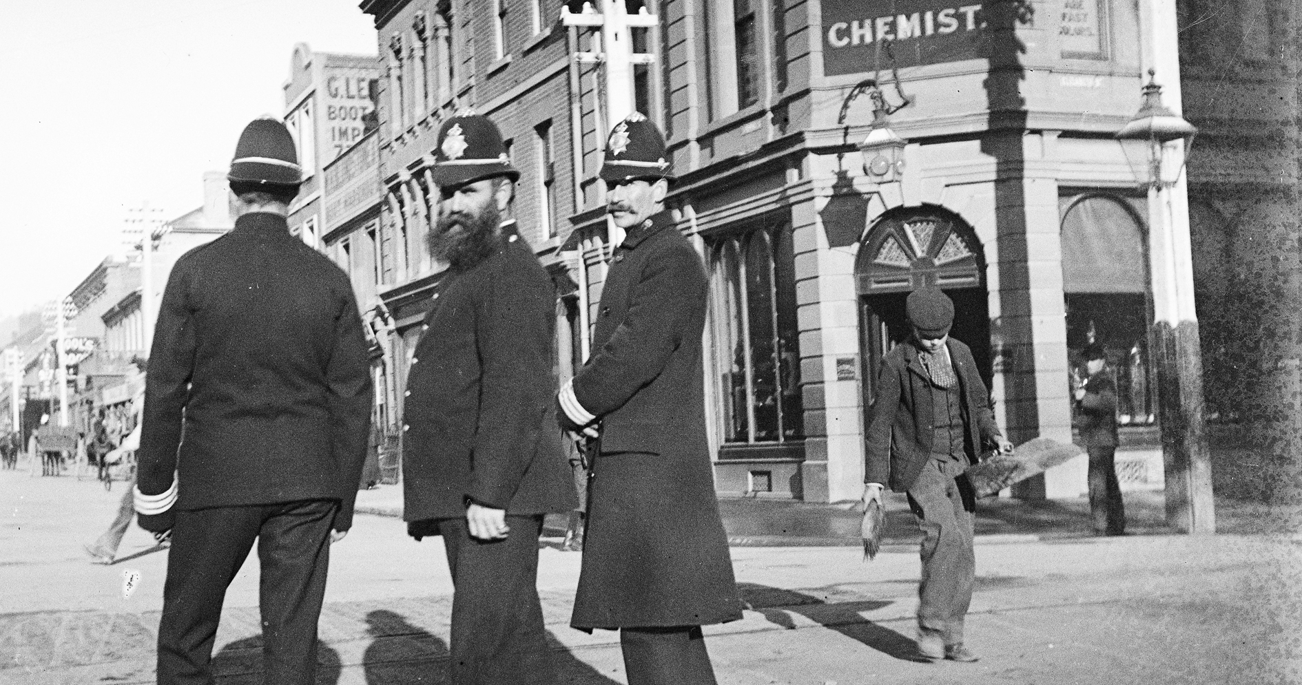Police in Hobart and a boy minding his own business,c1900,from  Tasmanian Archive and Heritage Office Commons .