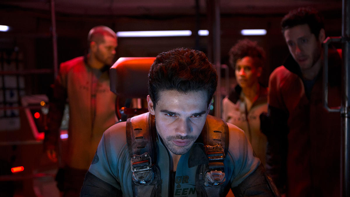 Steven Strait as Jim Holden, with the Rocinante's crew in the background