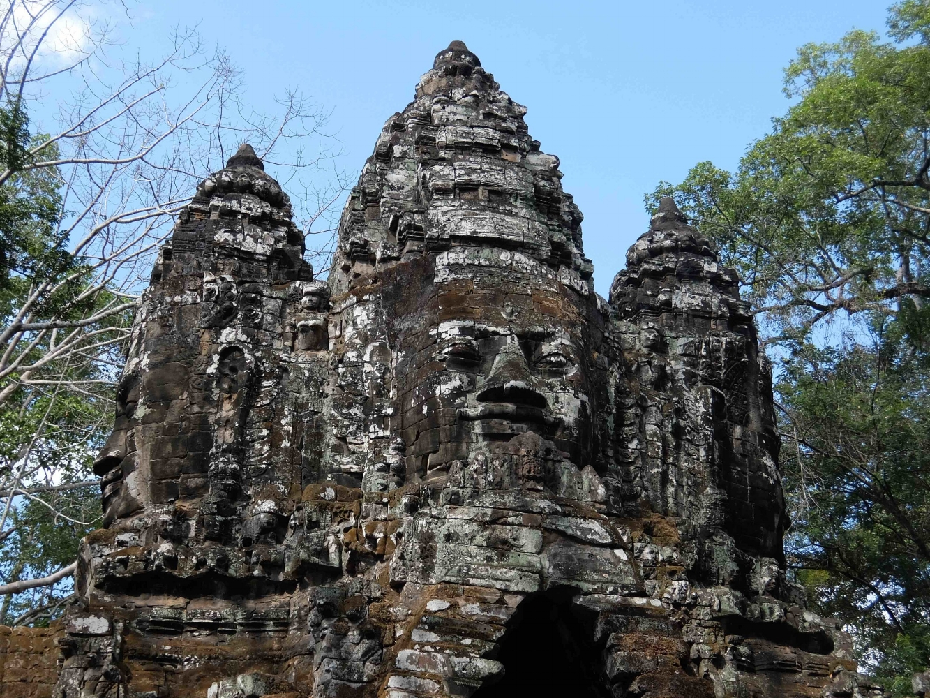 Experts on Angkor Thom debate whether the image is Jayavarman Vll or the Buddha or both. Photo by Lisa Mahoney. 2017.