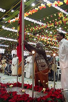 A mother of a lost child raises the Tamil Eelam flag on Maaveerar Naal 2002 in Germany