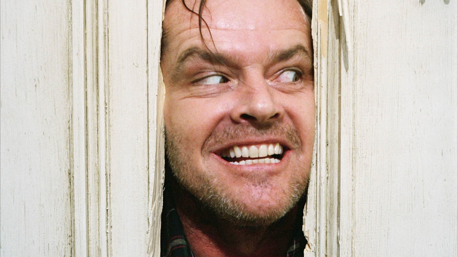 """Heeeere's Johnny!"" Jack Nicholson as Jack Torrence in Stanley Kubrick's  The Shining  (1980)."