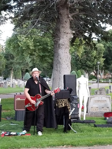 Paul Butler, performing under the name Redwing Blackbird, rocks the cemetery with his original tunes.