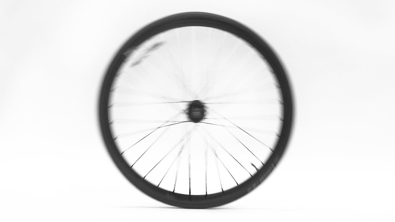54: The spokes on a rolling wheel are blurrier in the top half of the wheel than the bottom half because the point of rotation at the bottom of the wheel is motionless relative to the ground.  https://www.youtube.com/watch?v=jLV4NMsWxUc