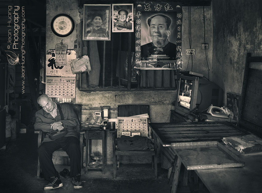 Senior-Citizen-Falling-Asleep-in-a-room-Full-of-Jutaposition-of-History-and-the-Present-Xingping-China-Copyright-Jean-Huang-Photography