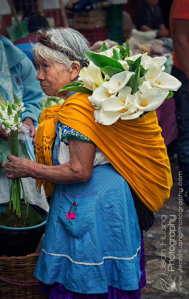 Senior-Lady-in-Traditional-Costume-Buying-Cala-Lilies-in-Sunday-Market-of-Cuetzalan-Mexico-Copyright-Jean-Huang-Photography