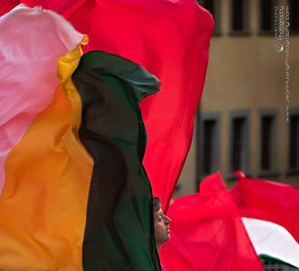 Flagwavers-being-Swampted-Arezzo-Italy-Copyright-Jean-Huang-Photography