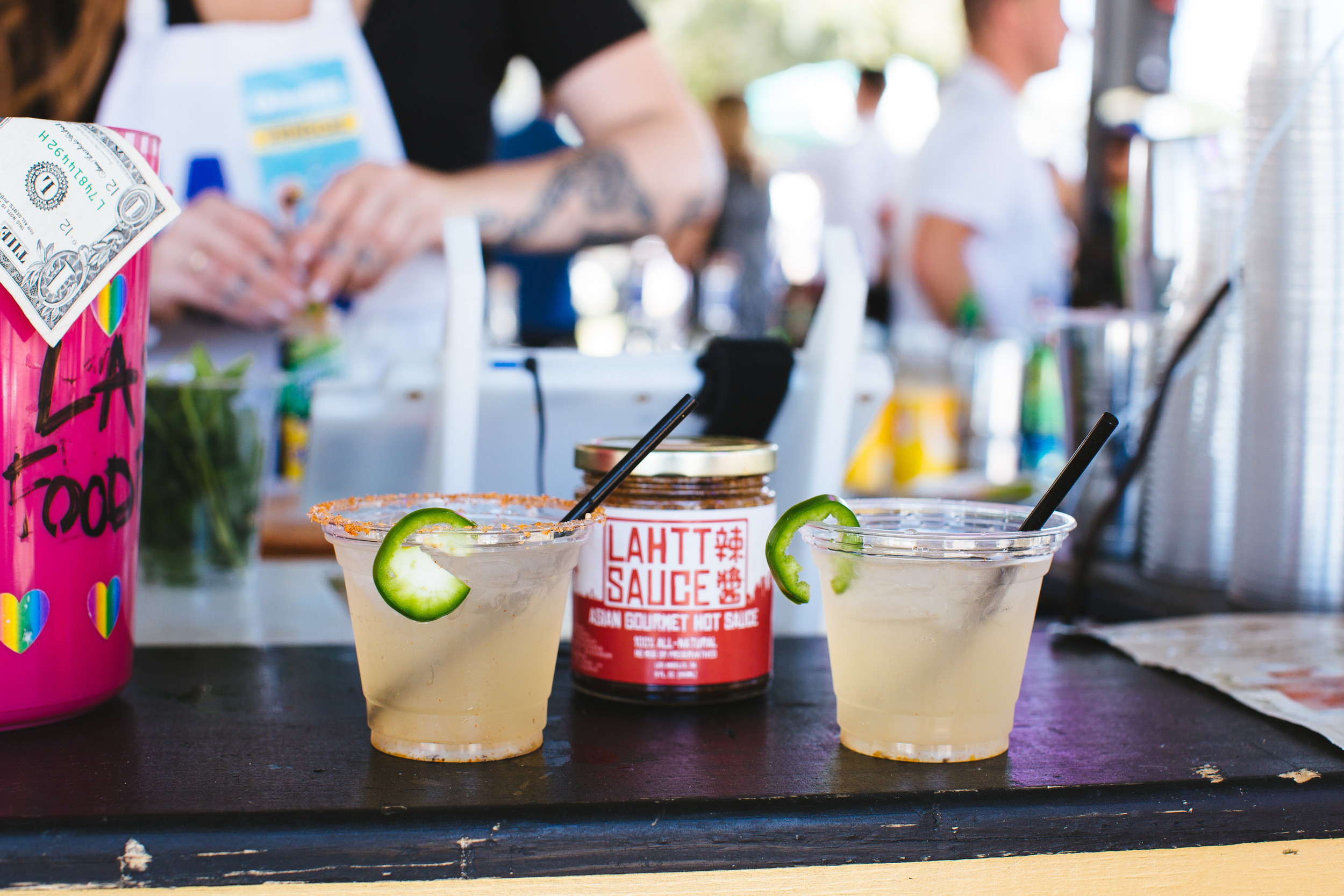 When LA Food Fest ran out of jalepenos, they asked us if they could use Lahtt Sauce for their margaritas...we honestly had no clue how it would taste...  Turns out... it tasted AMAZING!! The smokiness and depth of flavors in the sauce complimented the drinks perfectly! Even though they restocked on jalepenos, there was just no comparison. Once this masterpiece was created, the Lahtt Sauce Margarita was the crowd favorite.