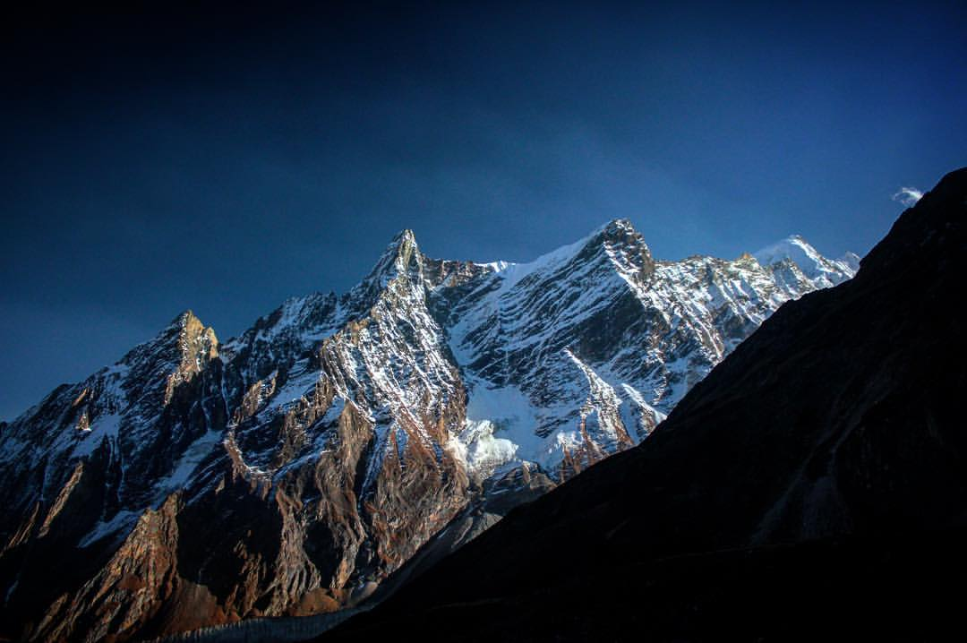 Risking waffling some donkey dung or falling off a mountain side path as wide as my boot's shoelace, I finally looked up to notice this craggy little knoll.— at  Manaslu Circuit Trek .