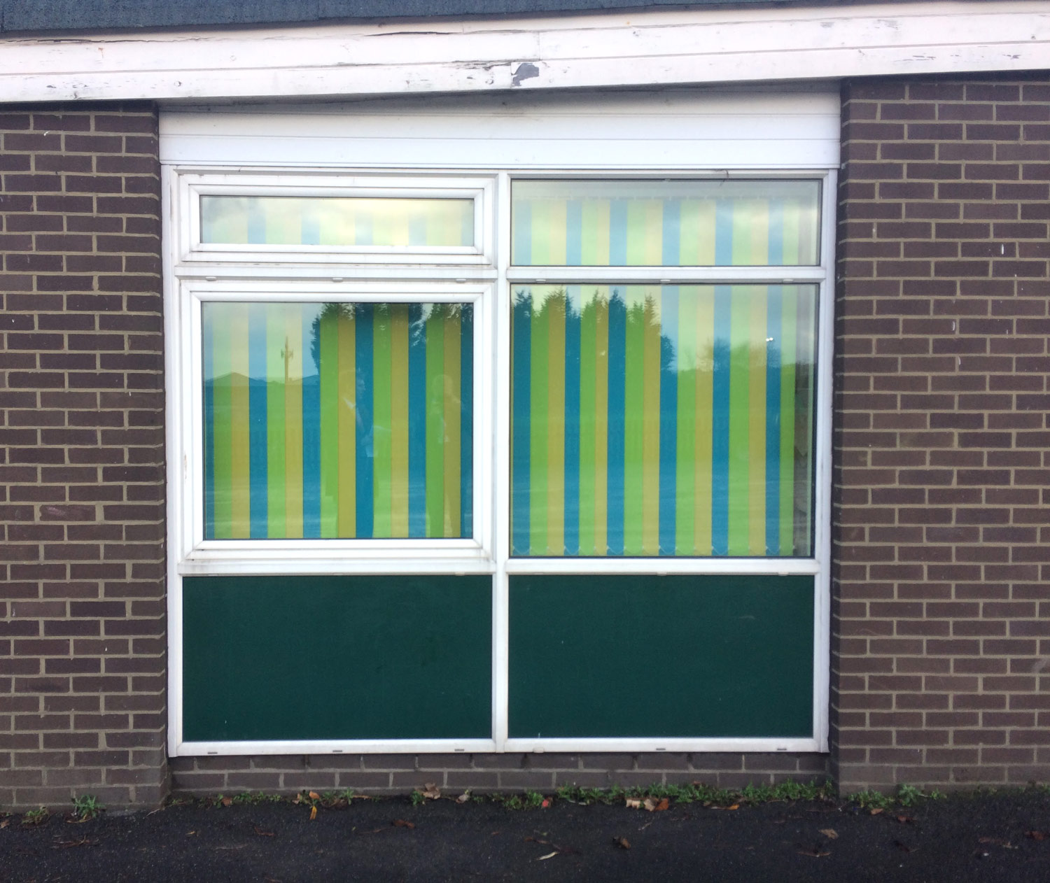 BEFORE: The window coverings are green